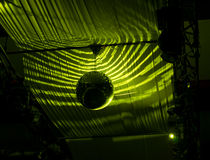 Disco Ball Hanging at Ceiling with Green Lights Royalty Free Stock Images