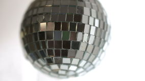 Disco ball hanging and spinning stock video
