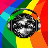 Disco ball and headphones over rainbow background Stock Image