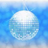 Disco ball isolated on light blue background. With light cloudy circles like bokeh effect Royalty Free Stock Photos