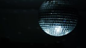 Disco ball with lights. Concept. Spinning disco ball in a dark room