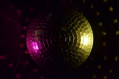Disco ball. That lights in yellow and pink colour Royalty Free Stock Photos