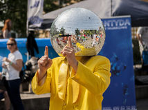 Disco Ball Man dancing in the street Stock Image