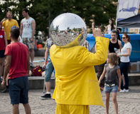 Disco Ball Man dancing in the street Stock Photo
