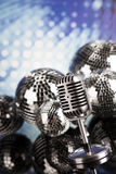 Disco Ball, Microphone and Music background Royalty Free Stock Photography