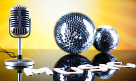 Disco Ball, Microphone, music saturated concept Royalty Free Stock Photography