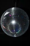 Disco ball. Mirrored disco ball suspended from a circular shape on the ceiling color tepnogo Stock Images