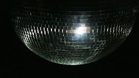 Disco Ball Mirrors Spin PAL . Disco ball spinning and sparkling as it rotates on a perfect loop. Loops seamlessly. Alpha stock footage