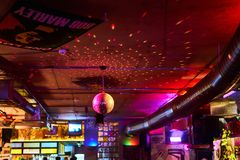 Disco ball, multi-colored background in the bar stock photography