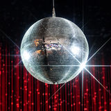 Disco ball nightclub. Silver disco ball with stars in nightclub with striped red and black walls Royalty Free Stock Images