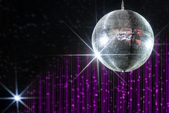Disco ball nightclub. Disco ball with stars in nightclub with striped violet and black walls lit by spotlight Royalty Free Stock Images