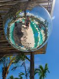 Disco ball reflecting green swimming pool. royalty free stock images