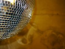 Disco Ball Reflections. Shiny disco ball  with lightbeams reflected in club Stock Photography
