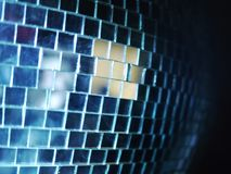 Disco Ball Reflections. Shiny disco ball  with lightbeams reflected in club Royalty Free Stock Photography