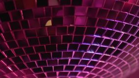 Disco ball rotating and reflecting lights in night club, party until morning stock video