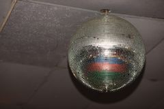 Disco ball with a smooth surface in a nightclub. Entertainment facilities Royalty Free Stock Photo