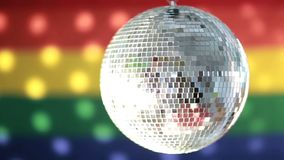 Disco ball spinning against rainbow flag Royalty Free Stock Photography