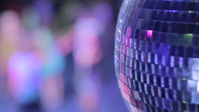 Disco ball in strobe lights at night club party, people dancing stock video footage