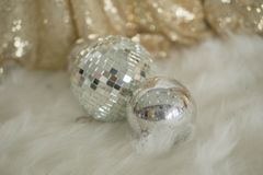 Disco ball is used to decorate the beautiful room. stock photos