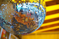 Disco ball on yellow background Royalty Free Stock Photos
