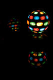 Disco Balls. A lit disco ball & its reflections Royalty Free Stock Photography
