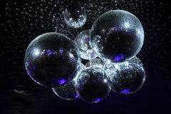 Disco balls in dark. Shiny disco balls on a dark background Royalty Free Stock Images