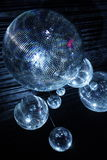 Disco balls in dark. Shiny disco balls on a dark background Stock Photography