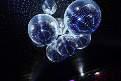 Disco balls in dark. Shiny disco balls on a dark background Royalty Free Stock Photo