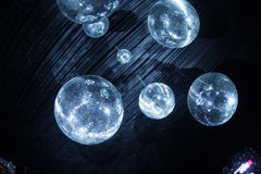 Disco balls in dark. Shiny disco balls on a dark background Stock Image