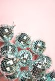 Disco balls for decoration party on pastel pink gradient background. Winter New Years Eve party holiday concept. top view, flat stock photography