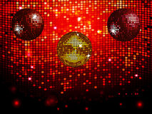 Disco balls over red sparkling tiles wall background Stock Images