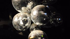 Disco Balls Spinning. A bunch of disco balls turning in a video with light reflecting off of them as they spin stock video footage