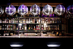 Disco bar. Counter with bottles in blurred background stock image