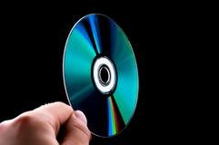 Disco cd abstracto del azul-rayo del dvd a disposición Imágenes de archivo libres de regalías