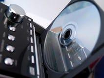 Disco CD en sistema estéreo Fotos de archivo libres de regalías
