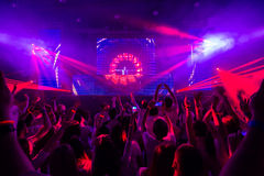 Disco club with dj on the stage. Royalty Free Stock Photos