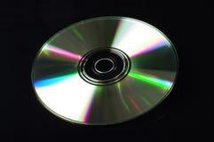 Disco compacto en el fondo negro Fotografía de archivo libre de regalías