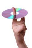 Disco compacto en un dedo Foto de archivo libre de regalías