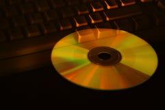 Disco compacto y teclado Imagenes de archivo