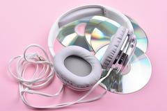 Disco cuatro con los auriculares Fotografía de archivo libre de regalías