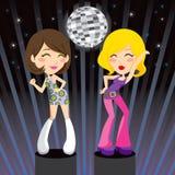 Disco Dance. Gorgeous brunette and blond go-go girls dancing disco music on nightclub podium Royalty Free Stock Photos