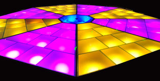 Disco dance floor with colorful lighting Stock Photo