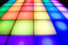 Disco dance floor with colorful lighting Royalty Free Stock Photos