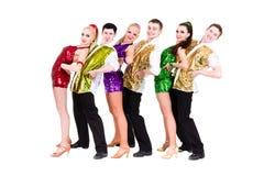 Disco dancer team. Isolated on white. Royalty Free Stock Photos