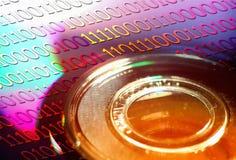 Disco de DVD con el código de Binaire Fotografía de archivo