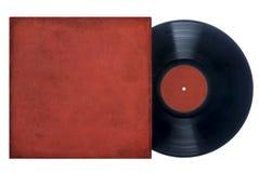 Disco de vinilo con la manga roja imagen de archivo libre de regalías