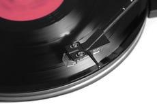Disco de vinilo de la rotación con la opinión superior de la etiqueta roja Foto de archivo libre de regalías