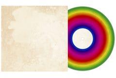Disco de vinilo del arco iris con la cubierta fotografía de archivo libre de regalías