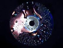 Disco del CD in acqua Immagini Stock Libere da Diritti