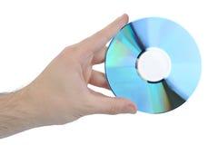 Disco del CD e della mano Fotografia Stock